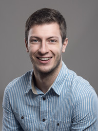 Business headshot of young man in dress shirt - Medford photography