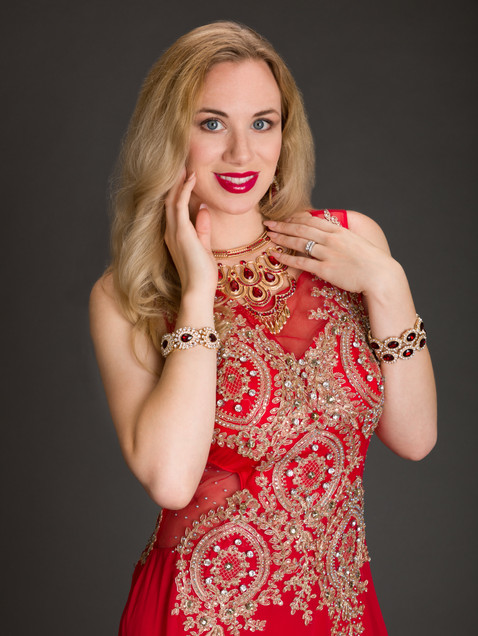 Blonde woman in red ornate gown with bracelets - Medford photographer, John Neilson