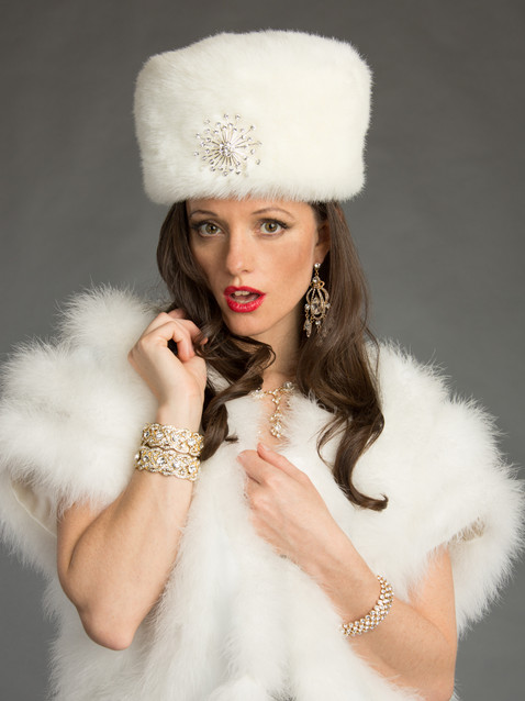 Photo of brunette woman in white fur - Medford photographer John Neilson
