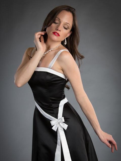 Elegant woman in black and white satin gown - Medford photographer, John Neilson