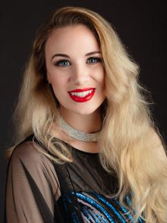 Headshot of blonde woman in blue dress - Medford photographer, John Neilson