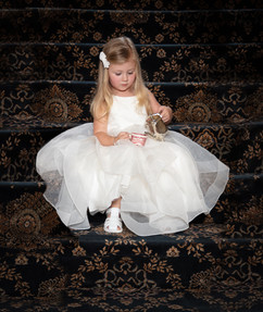 Photo of flower girl in white dress pouring tea - by Southern Oregon Photographer, John Neilson of Oregon Studio Group
