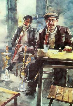 Men smoking waterpipe