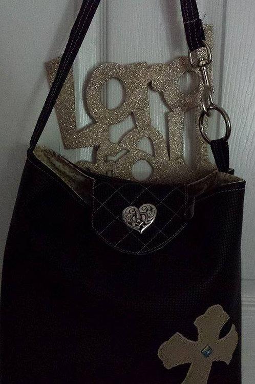 Single handled black handbag with cross