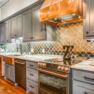 Fully stocked gourmet chef's kitchen featuring Cafe appliances, separate wine fridge & ice machine