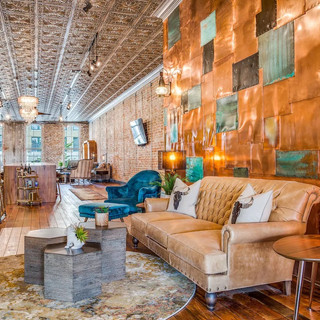 One of two large seating areas - situated in front of the beautiful custom, one of a kind copper wall