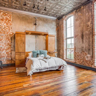 One of three versatile, queen size Murphy beds complete with luxurious, high end bedding & linens.  Oh, and that amazing view overlooking the historic Gainesville Courthouse is a plus!