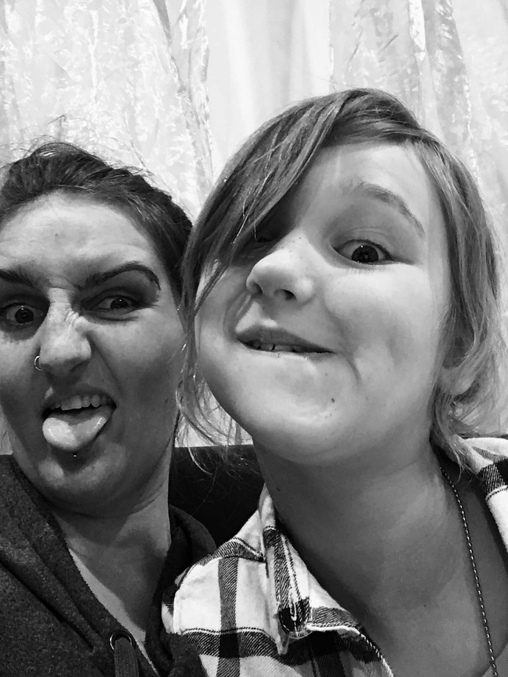 Josie and Emily Rigz taking silly selfies