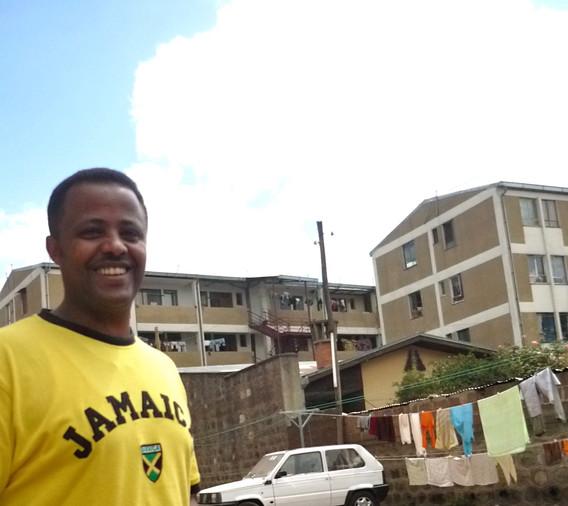 Robel Berhane, in front of his house, AA
