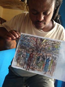 Tafari preparing and drawing new sketche