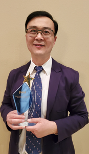 Jerry Song holds the SVIEF Disruptive Innovation Award at CES 2020 Las Vegas.