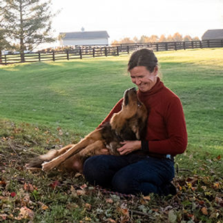 link to trainer bio, with image of trainer and her dog