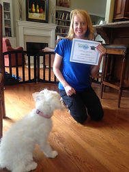 puppy with person holding graduation certificate