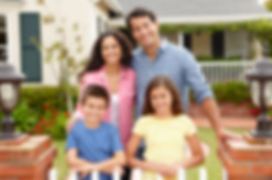 bigstock-Hispanic-family-outside-home-23