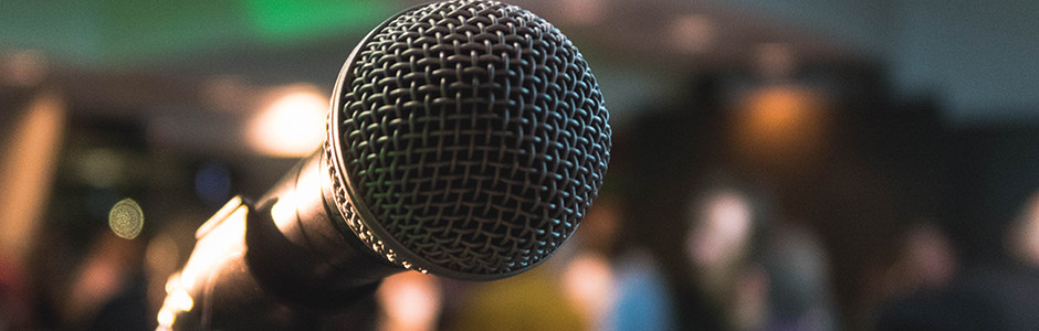 Public Speaking at a microphone