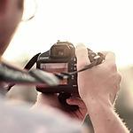 caméra homme prenant photographe photo
