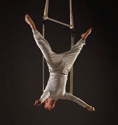 Aerial circus trapeze strapeze straps aerialist acrobat acrobatics walkabout stilts magic comedy quickchange peformance dance corporate entertainment street theatre cirque du soleil egyptian 20s gatsby escapology