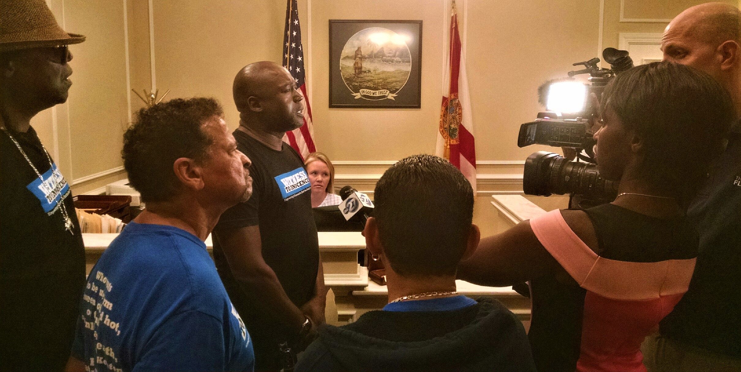 exoneree press conf in governors office.