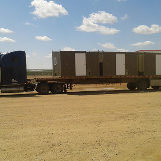 Semi loaded with buildings