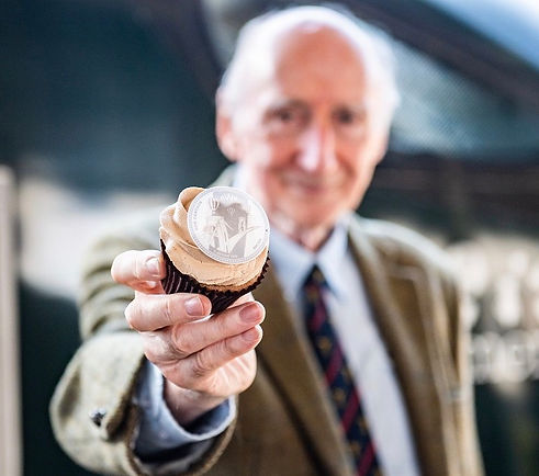 Don Cameron holding LHK cupcakes