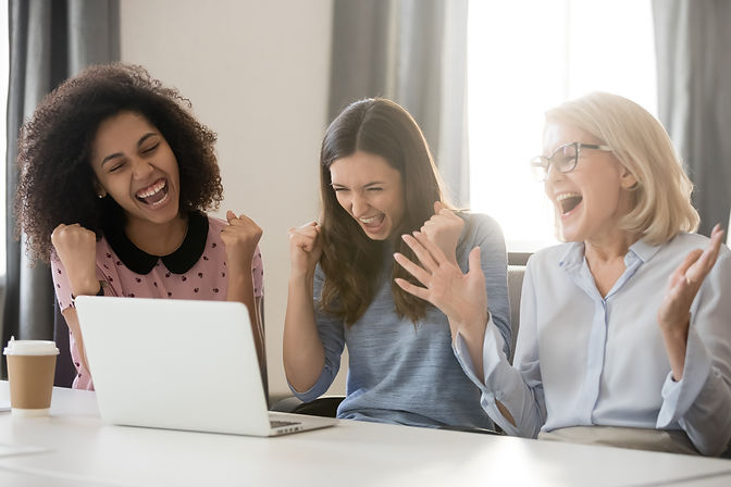 Diverse happy overjoyed young and old female employees team excited by online win reward b