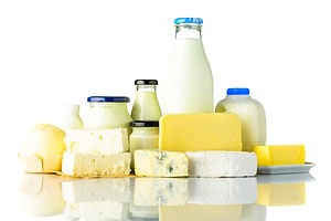 dairy-products-with-cheese-and-milk-on-w