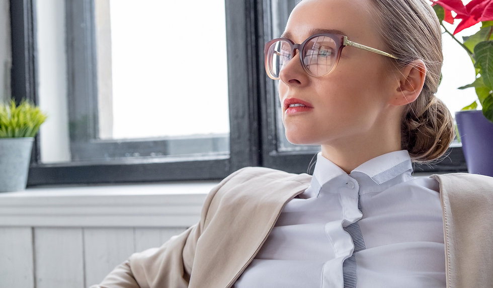 portrait-of-a-woman-in-eyeglasses-A9X96TK_edited.jpg