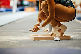 girl gymnast in chalk on hands and feet