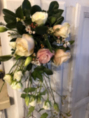 Hanging flower arrangements for the arch