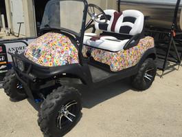sticker bomb golf cart.JPG