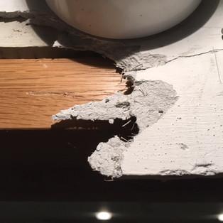 Broken asbestos insualtion board fire panel