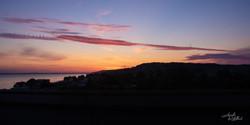 contre jour photo d'un coucher de soleil