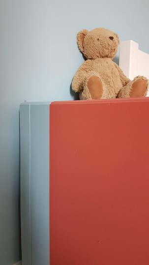 Coral and blue bedside drawers