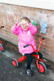 Young Explorers Pre-school & Nursery Cobham | Our Pre-school benefits from a large outdoor space with lots of activities to keep our little ones busy throughout the seasons