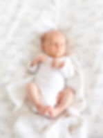 Richmond & Teddington lifestyle newborn and baby photographer. Baby photography offered in-home or on location