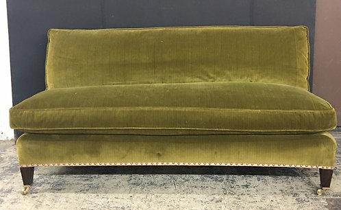 A vintage settee in chartreuse green velour