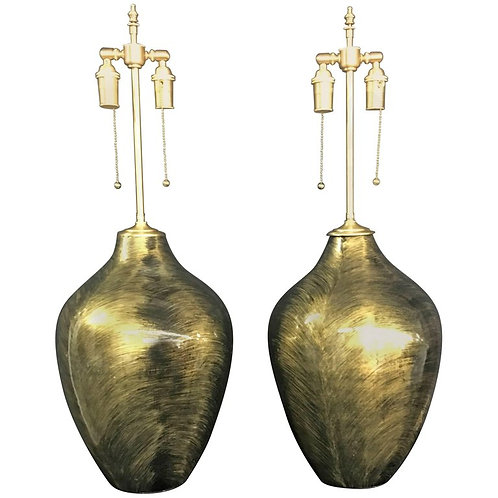 Pair of Luminescent Gold and Black Glazed Orbs