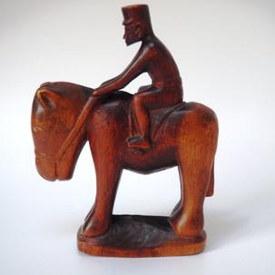 East African Kamba Askari on horse back