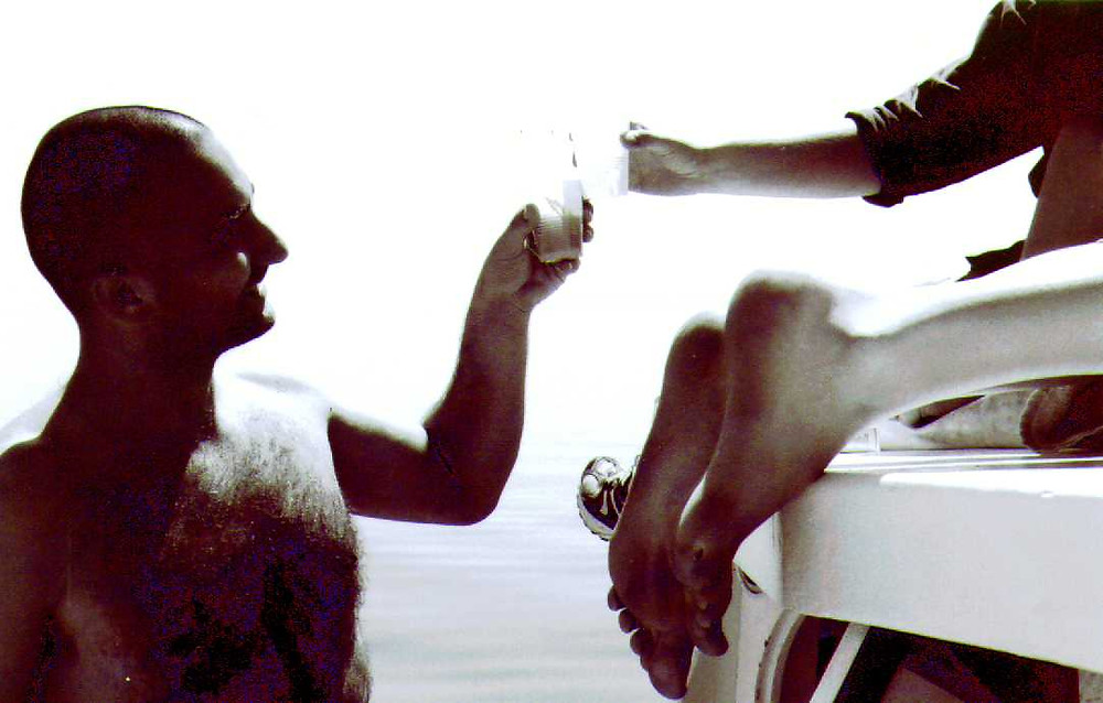 Daka (see below) and Peter (the co-author) toast during a day on the sea at Veli Losinj in 2001.