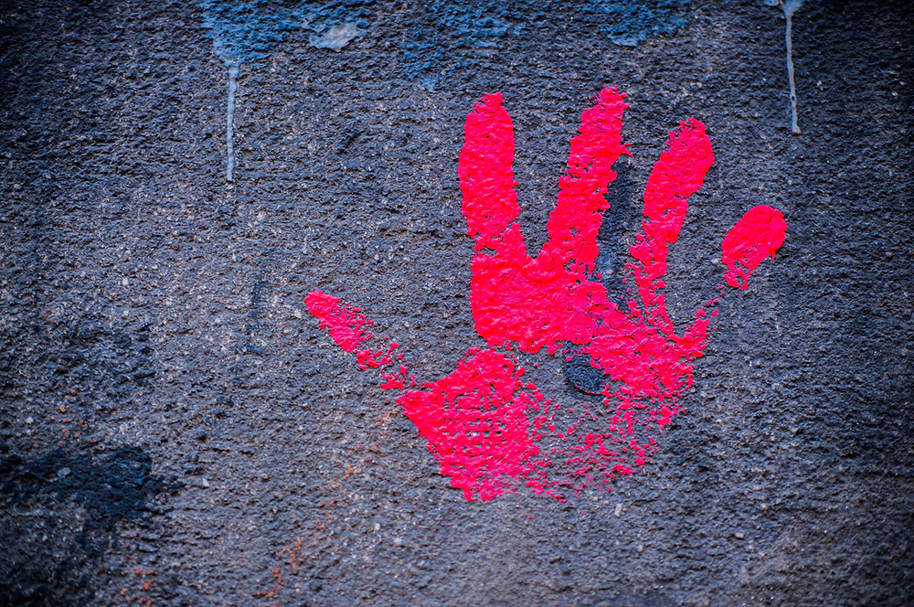 Red hand on the wall of the University of Belgrade in Serbia in 2018.
