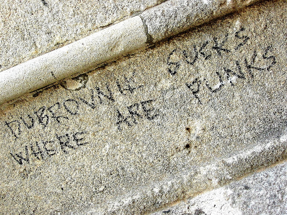 """""""Dubrovnink sucks. Where are punks?"""" - writing on the wall in Dubrovnik in Croatia in 2002."""