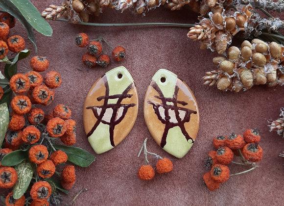 Oval Shaped Sigil Pattern Pendant Beads
