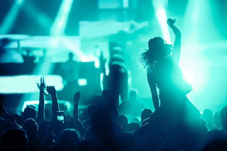 cheering-crowd-with-hands-in-air-at-music-festival-YKZ4VG9.jpg