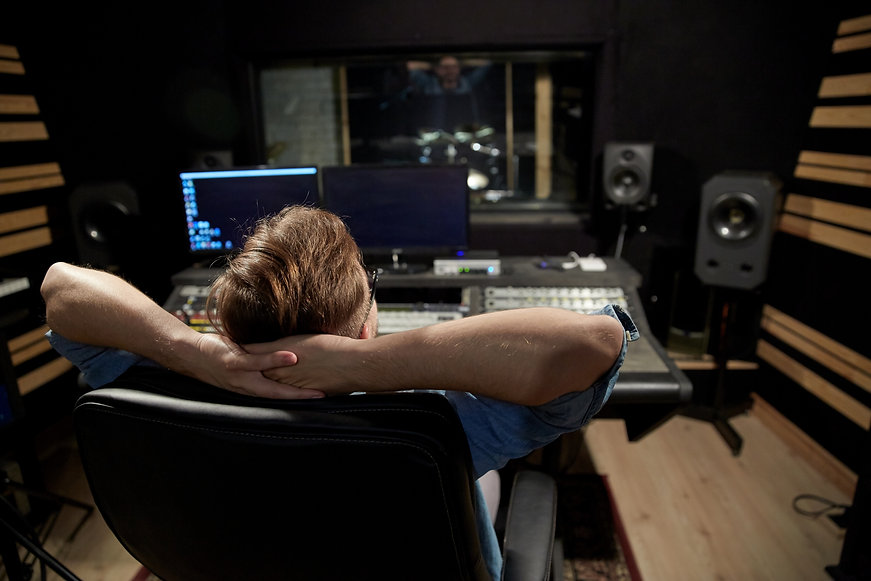 man-at-mixing-console-in-music-recording-studio-2021-08-26-22-50-43-utc.jpg