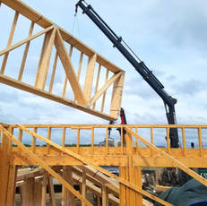 Truss system being craned onto frame