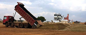 A truck dumping natural sand at the stockpile