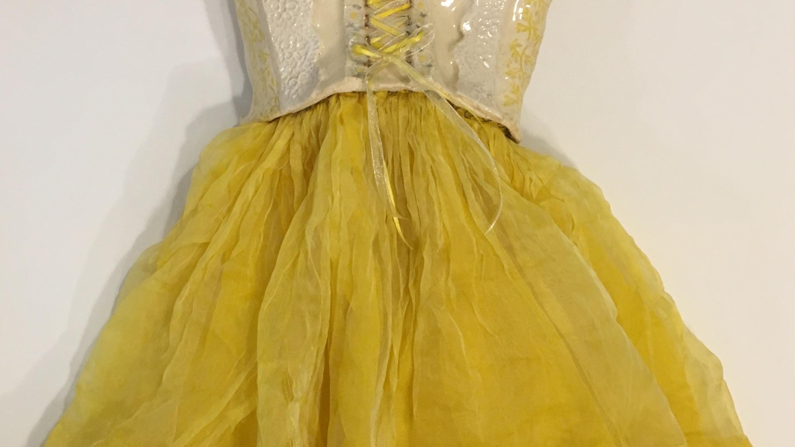 Dress before redoing beadwork