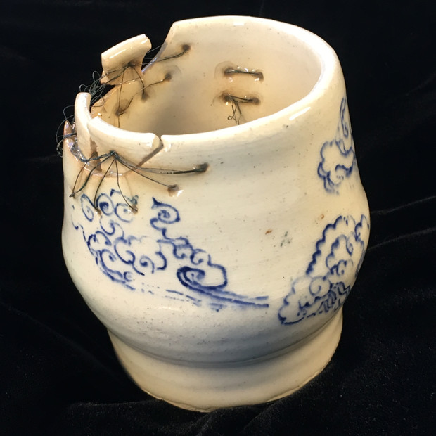 Mended  cup with clouds