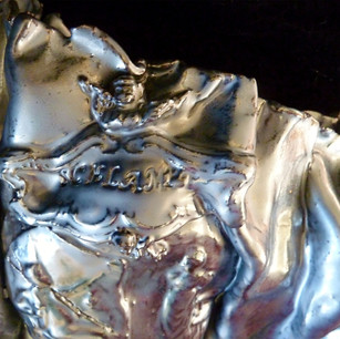 Battered Collectible Pewter Plate Schlamp Pantie (Detail)