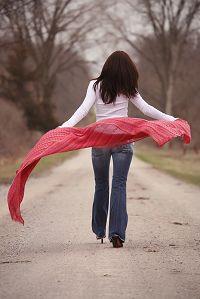 woman-walking-down-road-billowing-red-shawl.jpg